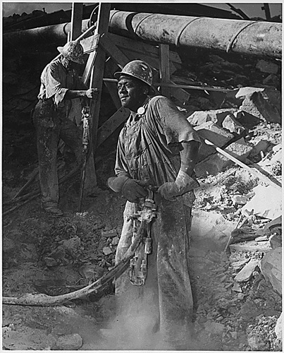 Black jackhammer operator at the Tennessee Valley Authority, June 1942.