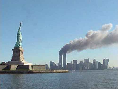 September 11, 2001 attacks in New York City: View of the World Trade Center and Statue of Liberty.